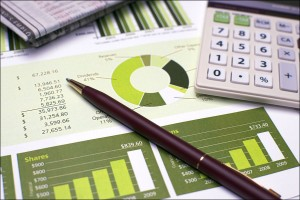 Financial Planning Pen and Calculator and Review of Year End Reports